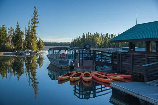 Kayaks and ferry boats on Jenny Lake in Wyoming