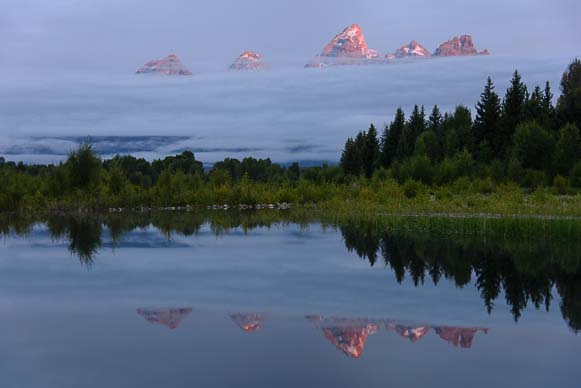 Sunrise lights the peaks in Grand Teton National Park Wyoming