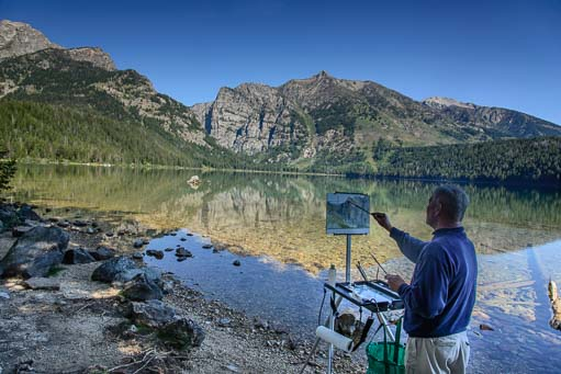 Artist painting at Phelps Lake Grand Teton National Park WY