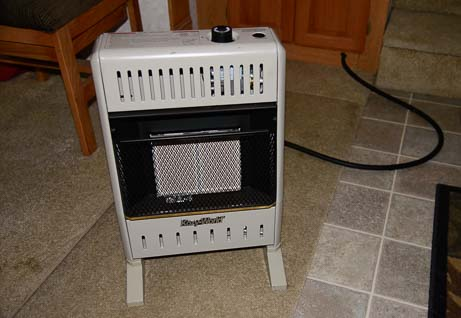 Kozy World Vent-Free Propane Heater connected to flexible gas hose