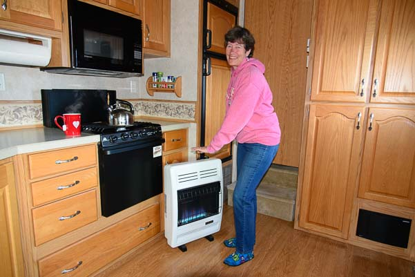 Warming my hands over a vent-free blue flame propane heater in my 5th wheel camper RV