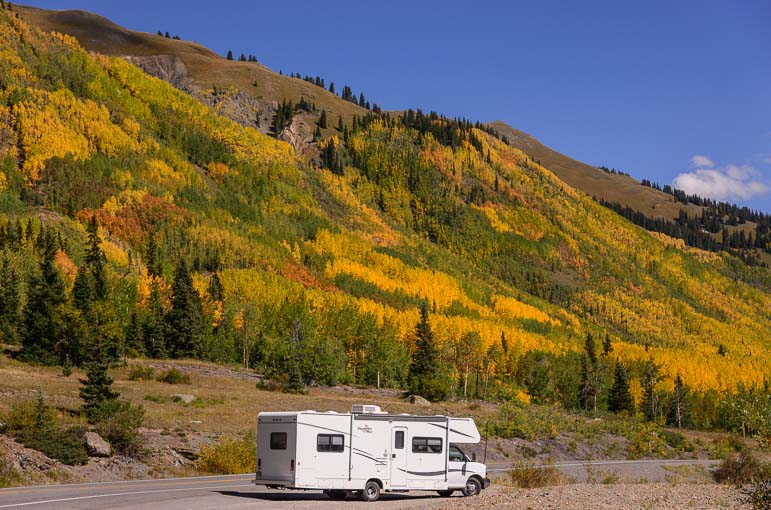 A motorhome at the peak of fall foliage season near Ouray Colorado