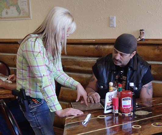 At Shooter's Grill in Rifle Colorado waitresses wear sidearms