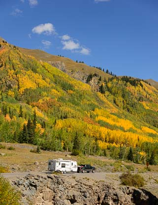 An RV in the golden aspen of Colorado