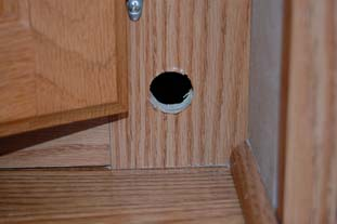 Hole at base of the cabinet for the gas hose