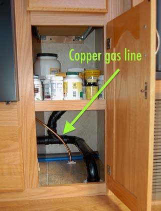 The gas hose for the heater will tap into an existing copper line in a kitchen cabinet