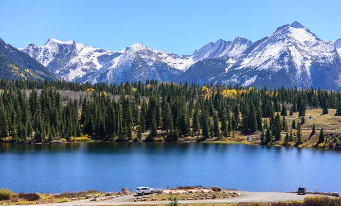 Snow capped mountains and a lake in Colorado