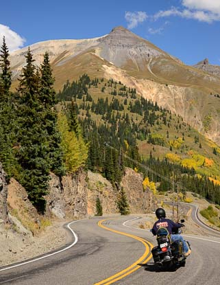 A motorcycle drives the Million Dollar Highway in Colorado