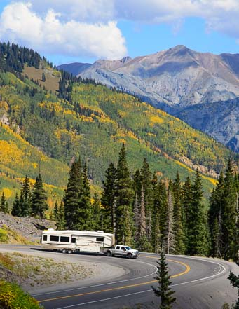 An RV descends Red Mountain Pass near Ouray Colorado