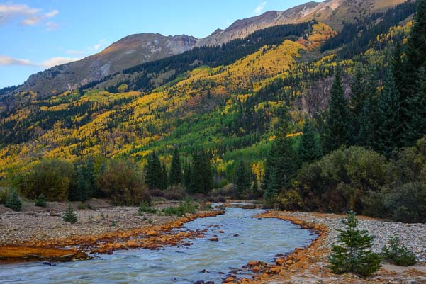 Red stone lined stream and Colorado autumn color