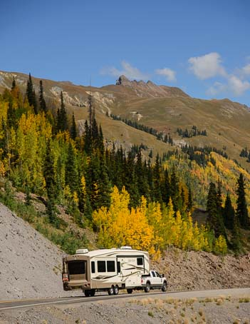 Fifth wheel trailer RV on Million Dollar Highway in San Juan Mountains Colorado