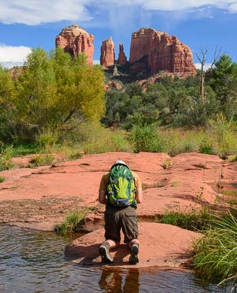 Kneeling in reverence at Cathedral Rock in Sedona Arizona