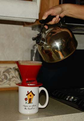 Making coffee by hand with a Melitta coffee filter