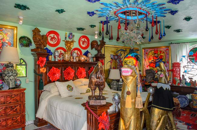 Crazy art and toy horse in the bedroom
