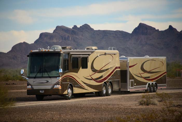 Motorhome towing a utility trailer in Quartzsite Arizona