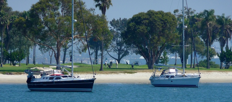 Sailboat Groovy anchored with Bella Marina at Glorietta Bay in San Diego Caifornia
