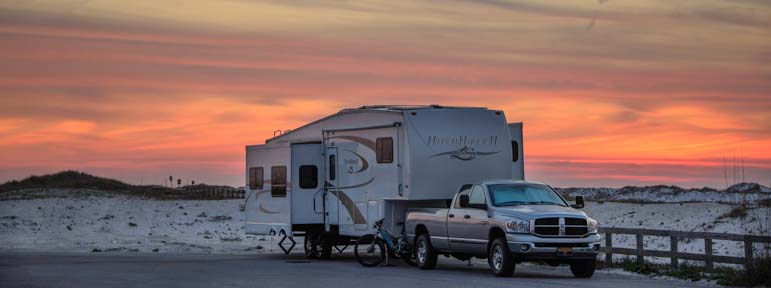 Fifth wheel trailer RV in Florida at sunset