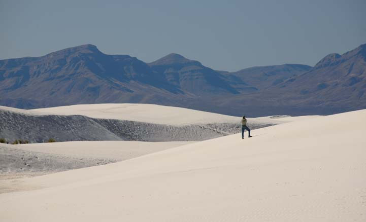 Vast landscapes and tiny person at White Sands National Park New Mexico