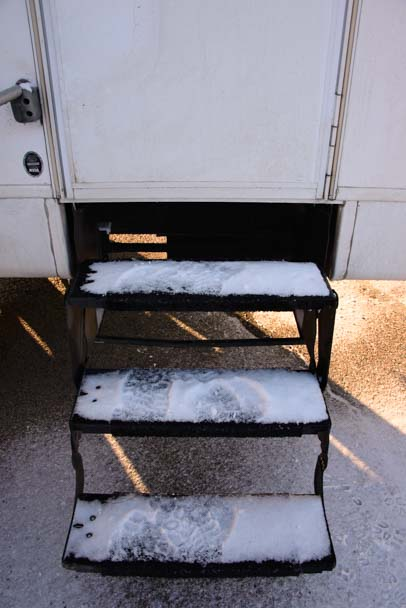 Snow on our RV steps