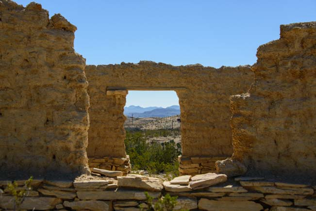 Looking out a ruined doorway in Terlingua Texas