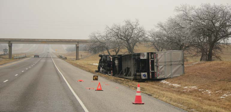 Overturned semi tractor trailer truck on I-20 in Texas