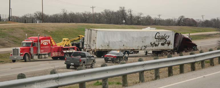 Freightliner semi-tractor trailer being removed from I-20 in Texas