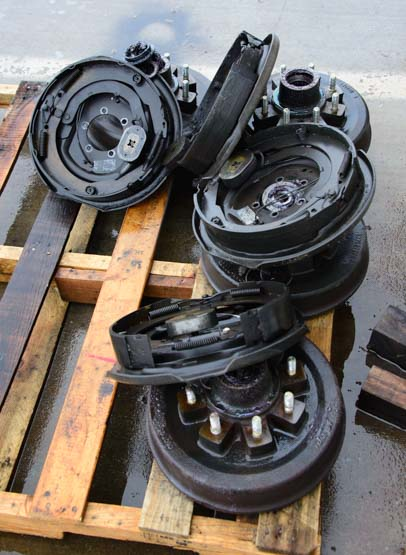 Old trailer electric drum brakes in the trash heap