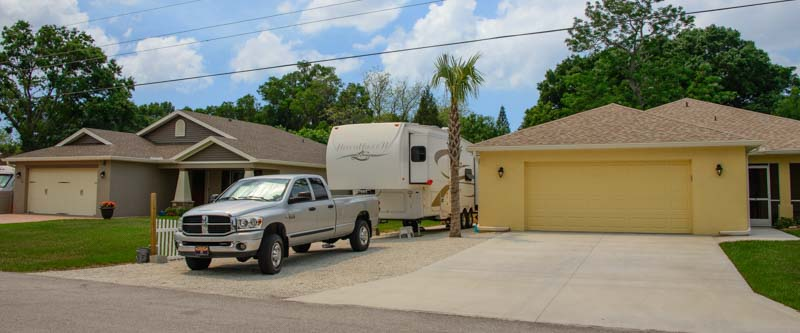 Fifth wheel RV between houses in Sarasota Florida