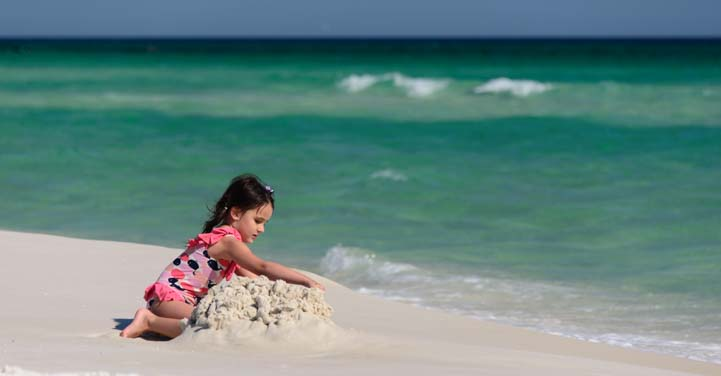Girl plays on Pensacola Beach in Florida