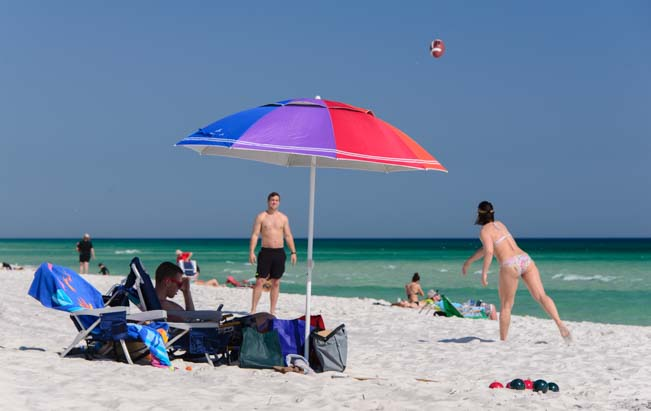 Kids play ball on Pensacola Beach in Florida
