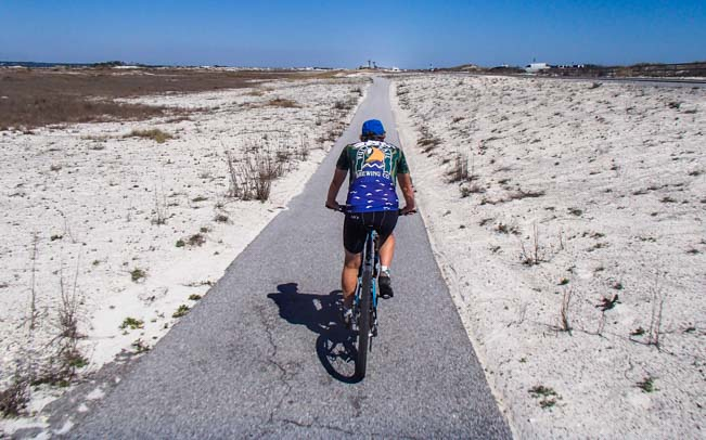 Riding bicycle on Gulf Islands National Seashore Florida