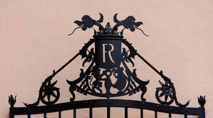 Ringling R insignia on metal gate