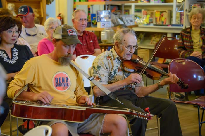 Bluegrass music on a dobro and fiddle