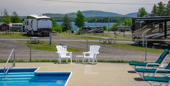 Swimming pool with motorhomes at Narrows Too RV Resort Mt Desert Maine