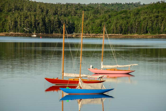 Sailboats at dawn in Maine harbor