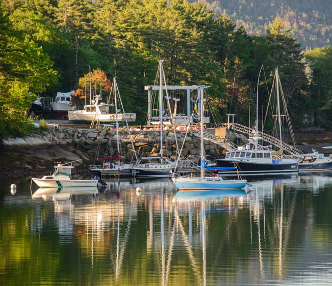 Dawn in Maine harbor with boats