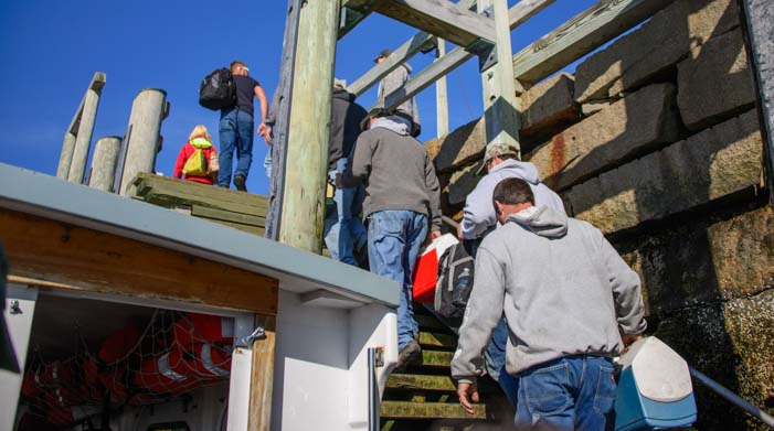 Workers get off Beal & Bunker mail boat ferry Double B on Cranberry Island Maine