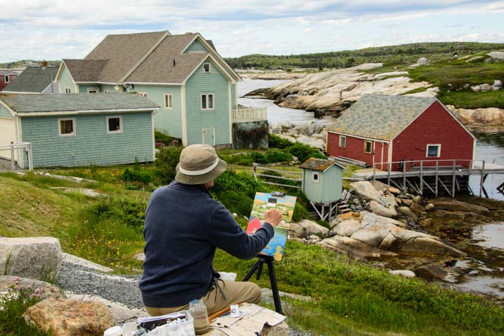 Artist painting Peggy's Cove Nova Scotia