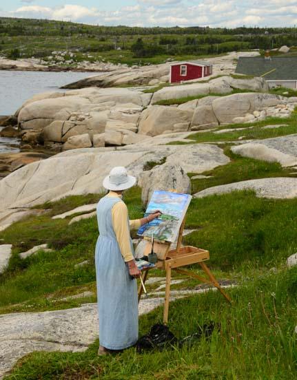 Artist painting Peggy's Cove Nova Scotia Canada
