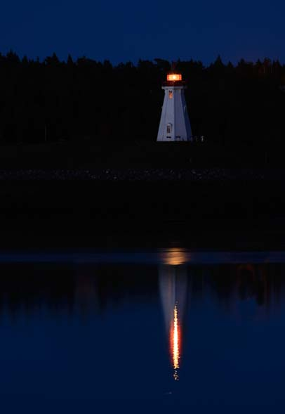 Lighthouse at night in Lubec Harbor Maine