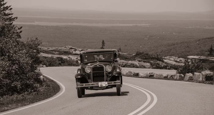 Antique Model A drives up Cadillac Mountain Acadia National Park Maine