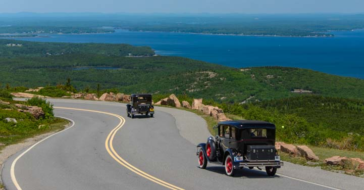 Two Ford Model A cars descend Cadillac Mountain Acadia National Park Maine