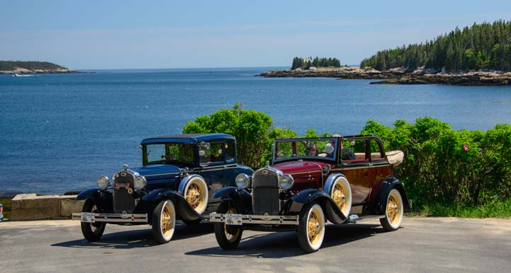 Two Ford Model A cars parked at Grindstone Neck Maine
