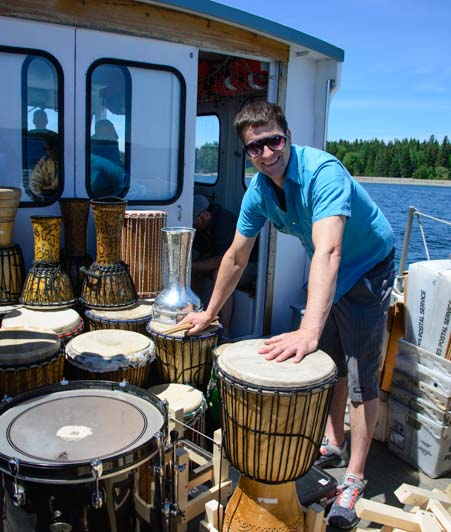 Bongo drum music teacher on Double B Islesford Mail Ferry Boat