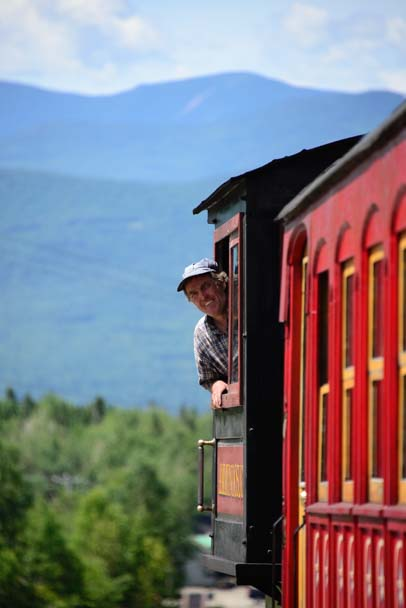 Engineer peeks out window Cog Railway Mt Washington New Hampshire