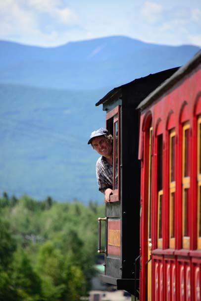 Engineer peeks out window Cog Railway Mt Washington New Hampshire