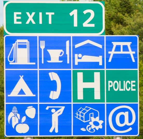 Exit road sign with icons New Brunswick Canada