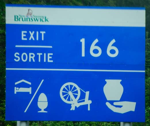 Egg spinning wheel and vase road sign New Brunswick Canada