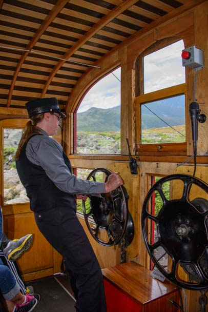 Brakeman controls the brakes on Mt Washington Cog Railway New Hampshire