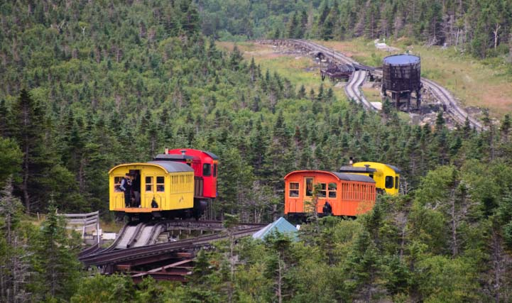 Two trains pass at Mt Washington Cog Railway switching station New Hampshire